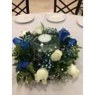 Centro de mesa con cristal enmedio con  vela flotante